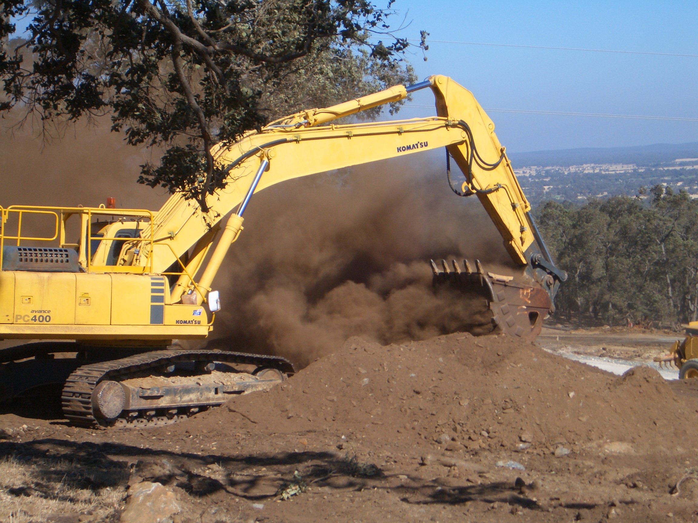 geotechnical engineering consultants using Digger Machinery digging in earth on site.