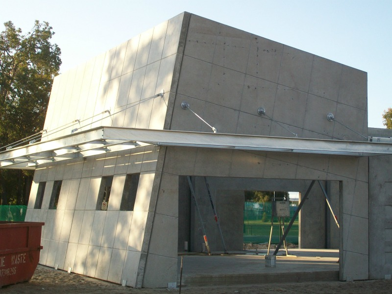 Structural engineering consultants erect walls allong the frame of the medical precinct.