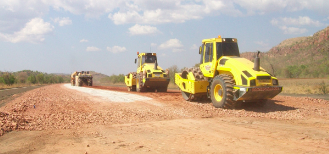 large construction vehicles in a sub base cement stabilisation trial as part of WMLs geotechnical service for the Ord River Expansion project.
