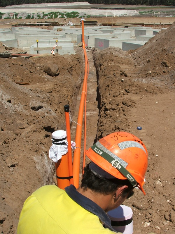 WML structural engineering consultants digging a piping trench at the mine site.